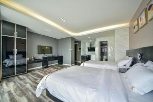 K Family Boutique Short-Term Hotel(Dali Gold K Sea View Branch), Hotels  Dali - big - 23