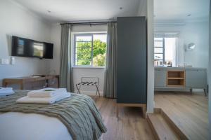 Rozenhof Guest Accommodation, Гостевые дома  Стелленбос - big - 44