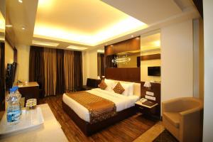 Hotel Golden Grand, Отели  Нью-Дели - big - 13