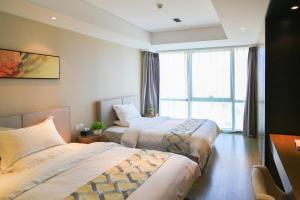 Mengwan Harbor Apartment, Apartmanok  Csingtao - big - 21