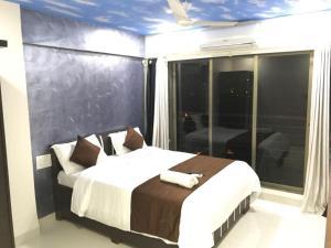 Executive Highrise - 2 Bhk Services Apartment, Апартаменты  Мумбай - big - 10