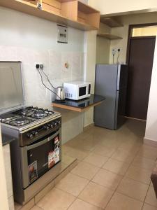 Winsor - Cijana Gardens, Apartmanok  Nairobi - big - 6