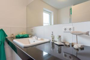 Ferienwohnungen Rosengarten, Apartments  Börgerende-Rethwisch - big - 32