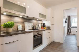 Ferienwohnungen Rosengarten, Apartments  Börgerende-Rethwisch - big - 33