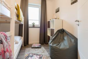 Ferienwohnungen Rosengarten, Апартаменты  Бёргеренде-Ретвиш - big - 4