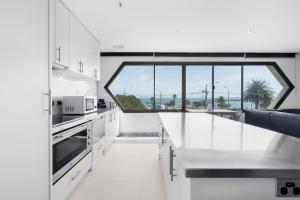 Elaine - Beyond a Room Luxury Beachside Apartments