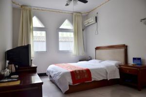 Yijie Hotel Wuling Mountain Longxi Villa, Hotel  Miyun - big - 24