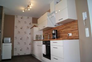 Fe Wo _Sommersprosse_, Appartamenti  Börgerende-Rethwisch - big - 18
