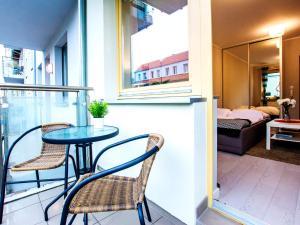 VacationClub - Kwartał Róży Wiatrów Apartment 12