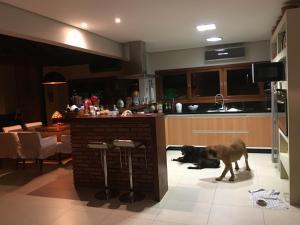 Casa de Ponta das Canas, Holiday homes  Florianópolis - big - 12