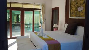 Les Palmares Villas, Курортные отели  Банг Тао Бич - big - 89