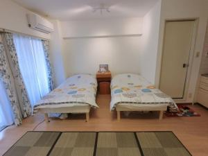 Onehome Inn Apartment Ootsuka XM2, Апартаменты  Токио - big - 6