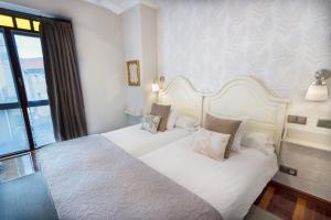 Une image de Cuatro Caminos Rooms
