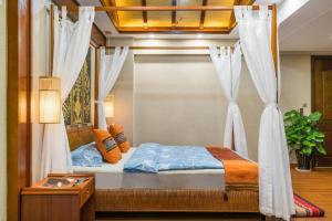 Xishuangbanna Shanlin Guest House, Отели  Jinghong - big - 3