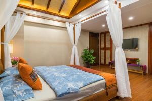 Xishuangbanna Shanlin Guest House, Отели  Jinghong - big - 5