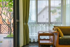 Xishuangbanna Shanlin Guest House, Отели  Jinghong - big - 10