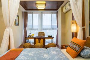Xishuangbanna Shanlin Guest House, Отели  Jinghong - big - 11
