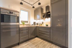 Ferienwohnungen Rosengarten, Apartments  Börgerende-Rethwisch - big - 67