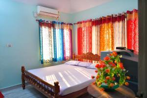 Omkaram Homestay, Privatzimmer  Trikunnapuzha - big - 14