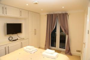 Cosy San Remo London Flat, Апартаменты  Лондон - big - 11