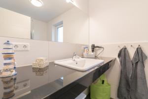 Ferienwohnungen Rosengarten, Apartments  Börgerende-Rethwisch - big - 105