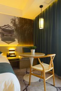 Tongxiang Wuzhen Shangjin Hotel, Отели  Wujiaqiao - big - 4
