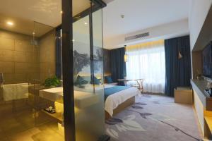 Tongxiang Wuzhen Shangjin Hotel, Отели  Wujiaqiao - big - 9