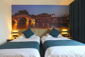 Tongxiang Wuzhen Shangjin Hotel, Отели  Wujiaqiao - big - 12