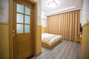 Nanwu Guesthouse, Penziony  Wujiaqiao - big - 2