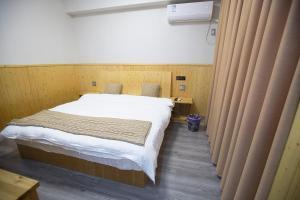 Nanwu Guesthouse, Penziony  Wujiaqiao - big - 5