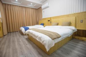 Nanwu Guesthouse, Penziony  Wujiaqiao - big - 6