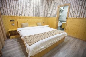 Nanwu Guesthouse, Penziony  Wujiaqiao - big - 8