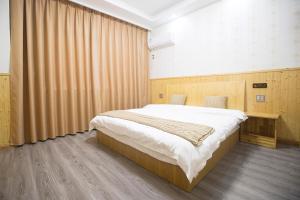Nanwu Guesthouse, Penziony  Wujiaqiao - big - 9