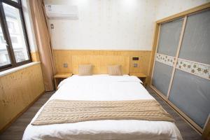 Nanwu Guesthouse, Penziony  Wujiaqiao - big - 13