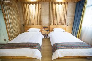 Nanwu Guesthouse, Penziony  Wujiaqiao - big - 18