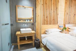 Nanwu Guesthouse, Penziony  Wujiaqiao - big - 20