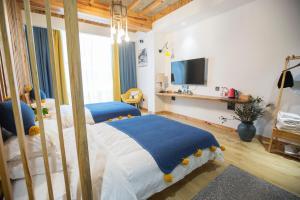 Nanwu Guesthouse, Penziony  Wujiaqiao - big - 21