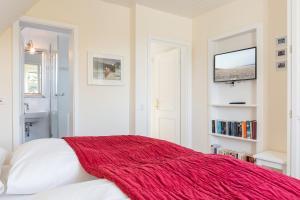 _Kuerzdoerfers_ App_ 3 OG, Apartmanok  Wenningstedt - big - 28