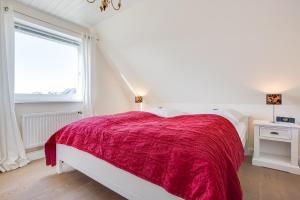 _Kuerzdoerfers_ App_ 3 OG, Apartmanok  Wenningstedt - big - 26