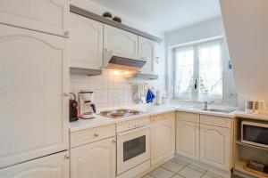 _Koeoevenhues_ App_ 5_OG_re, Apartmanok  Wenningstedt - big - 24