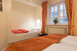 _Klingler_s Hues_ App_ 1_ EG links, Apartmanok  Wenningstedt - big - 19