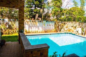 Poolside Garden Home in Paraña..