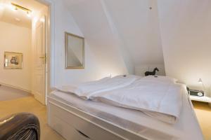 _Carolin_ App_ 3_ OG_ links, Apartmány  Wenningstedt - big - 16