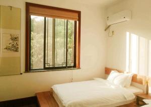 Pure-Land Villa, Ubytování v soukromí  Suzhou - big - 25