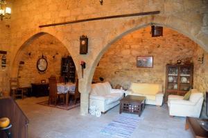 kostas stone house