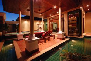 Les Palmares Villas, Курортные отели  Банг Тао Бич - big - 129