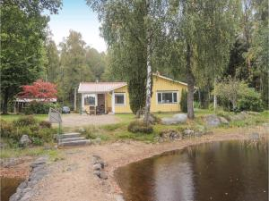 A picture of Three Bedroom Holiday Home in Hallaryd
