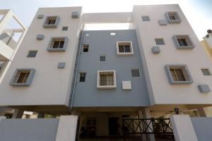 Amigo Service Apartment-Baner