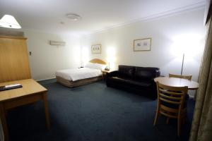 Carlyle Suites & Apartments