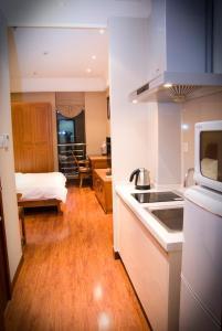 Chenlong Service Apartment - Yuanda building, Aparthotely  Šanghaj - big - 10